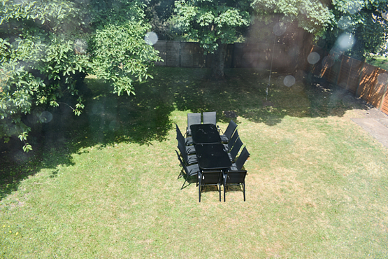 Back garden with seating area for up to 12 people